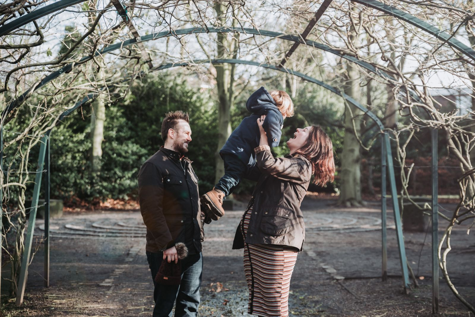 Family laughing outdoor photoshoot Manchester